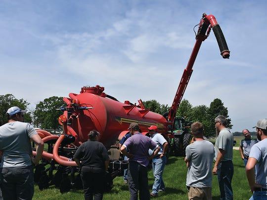 Participants check out a new low disbturbance manure