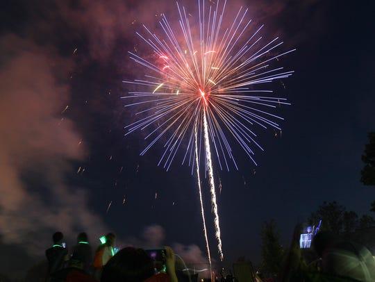 Fireworks explode over S.T. Morrison Park in Coralville