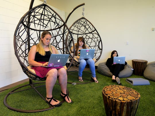 (L-R) Ally Mnich of Holmdel, marketing coordinator, Leann Burns of Keyport, marleting coordinator, and Amanda Gagliano of Marlboro, marketing associate, work together on swing chairs and a bean bag chair at Vydia inside Bell Works, which is slowly becoming one of the hippest places to work in New Jersey, if not the country, in Holmdel, NJ Wednesday, June 22, 2017.