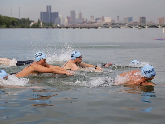 Participants in the half mile race take off during the Motor City Mile swimming competition and charity event on Belle Isle in Detroit on Thursday, July 6, 2017.