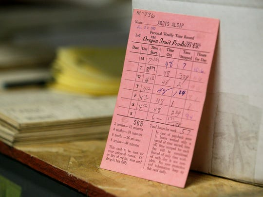 Ardis Birch's time card from 1962 sits on a shelf in