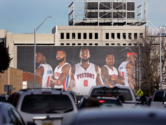 A billboard of the Detroit Pistons near the site of the future Little Caesars Arena in Detroit on November 22, 2016.