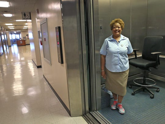 Denise Cummings, a service elevator operator at the City-County Building since 1981, pauses on the 25th floor, which houses the mayor's offices. The service elevator transports Mayor Joe Hogsett and his staff.