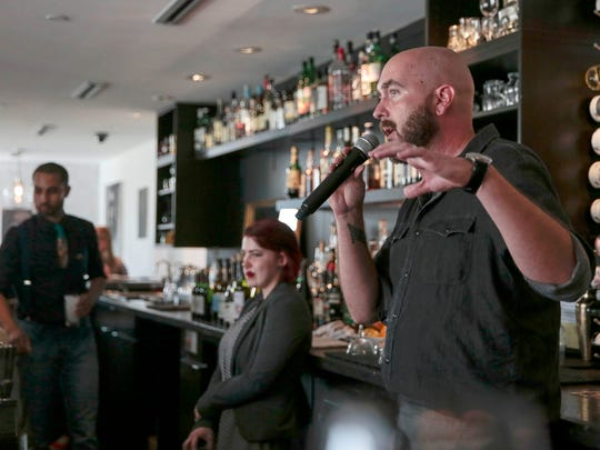 Matt Baldridge, chef and owner of The Conserva, speaks to  the guests during dinner.