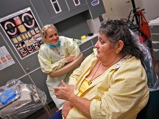 Loretta Scarborough, right, talks with IU dental student