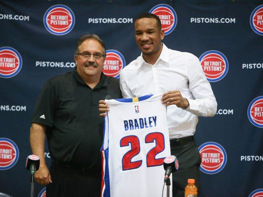 Detroit Pistons president and head coach Stan Van Gundy, left, introduces new guard Avery Bradley on Thursday, July 13, 2017 at the practice facility in Auburn Hills.
