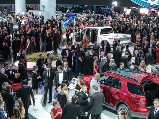 People look through the Ford exhibit during the 2017 North American International Auto Show Charity Preview at Cobo Center in Detroit on Friday, January 13, 2017.