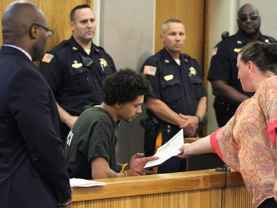 """Andreas Erazo, 18, is handed court documents during his initial appearance in Freehold Friday, July 14, 2017, where he was charged with the murder of 11-year-old AbbieGail """"Abbie"""" Smith in Keansburg."""