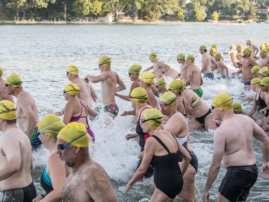 Swimmers start at Willard Beach for the 90th Annual Goguac Lake Swim on Saturday.