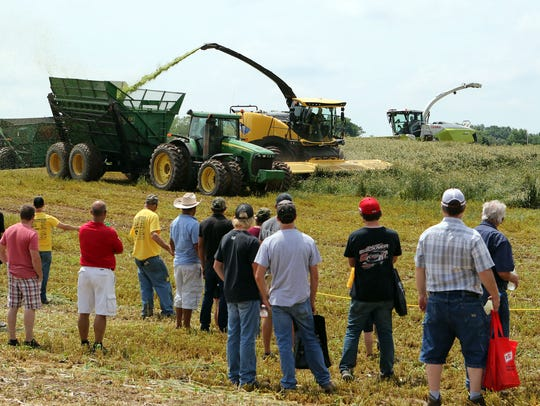 Guests at Farm Technology Days at Ebert Enterprises in Algoma watch a field demonstration of choppers on July 12, 2017.