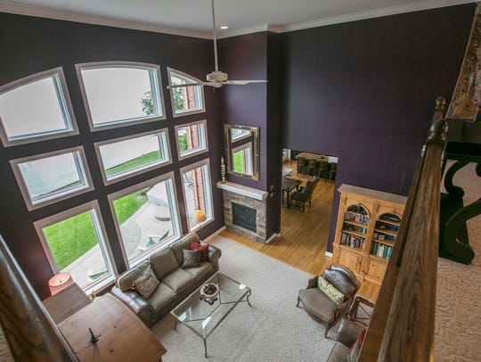 The two story great room has floor to ceiling windows