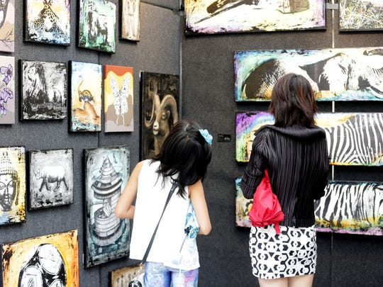 Visitors can explore the work of more than 1,000 artists -- from Michigan and around the globe --  at the Ann Arbor Art Fair.