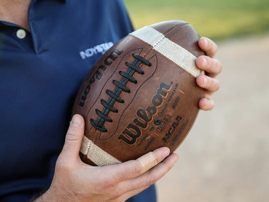 IndyStar sports columnist Gregg Doyel traced the history of a football he bought used in Indianapolis, leading him through the high school and college ranks before he finally found its roots at Roncalli High School.
