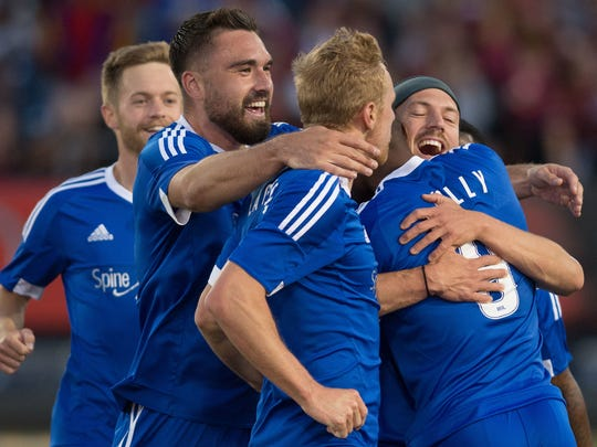 The Reno 1868 FC players celebrate against Sacramento