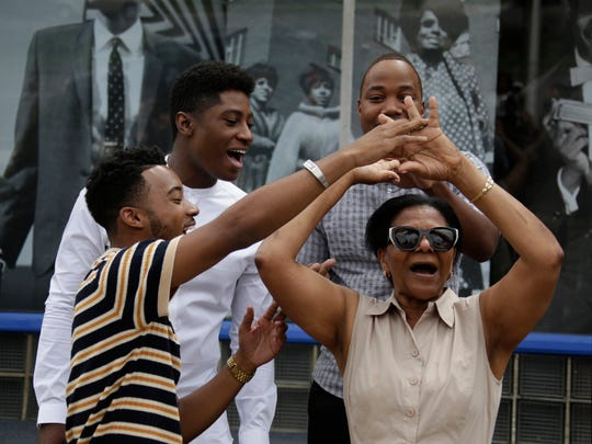 Cast member from the movie 'Detroit'  Algee Smith grabs an unsuspecting Amelda Smith, 70, of New York for a quick dance as Joseph David-Jones, back left, and Leon Thomas III, look on. The actors stop by the Motown Museum in Detroit Sunday July 23, 2017. 'Detroit', the drama from Oscar-winning director Kathryn Bigelow, will have its world premiere at the Fox Theatre in Detroit on Tuesday. It opens at theaters in limited release July 28 and at 2,000-plus theaters August 4. Mandi Wright/Detroit Free Press