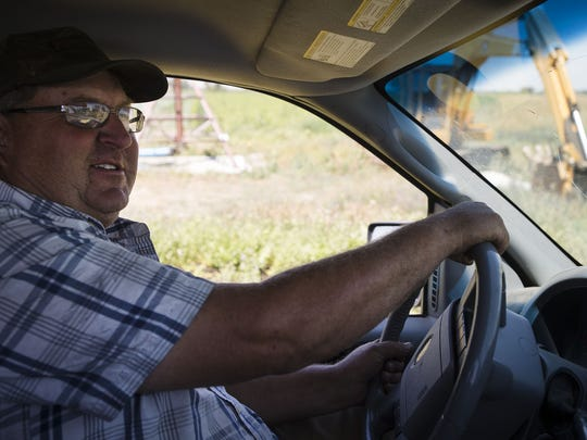 Joe Miller drives the backroads through the his land, Wednesday, July 19, 2017, at Miller Farms in Platteville, Colo.