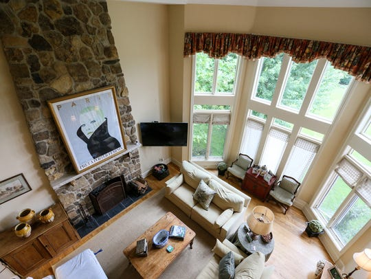 "Two-story windows overlook the family room at ""Willow"