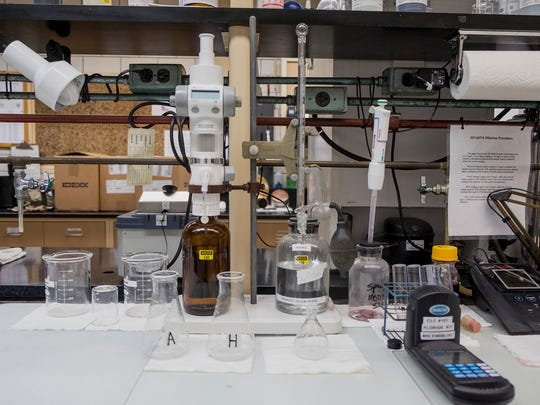 Various chemicals and containers are used to test water samples for alkalinity. Alkalinity represents the buffering capacity of water, or its abaility to absorb acids, which can be an indicator of possible contaminants.