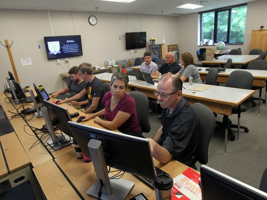 Teachers gather for a computer science development