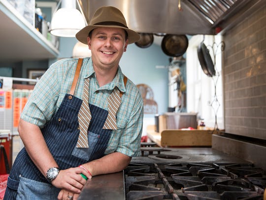 Owner and executive chef Kieron Hales poses for a photo in the farmhouse kitchen at Zingerman's Cornman Farms, Tuesday, August 1, 2017 in Dexter.