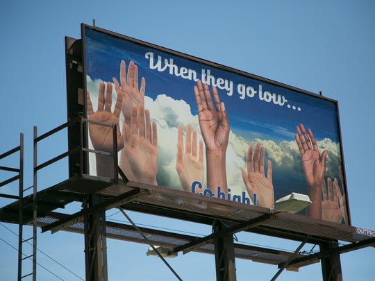 A billboard with artwork by Nicole Macdonald is seen