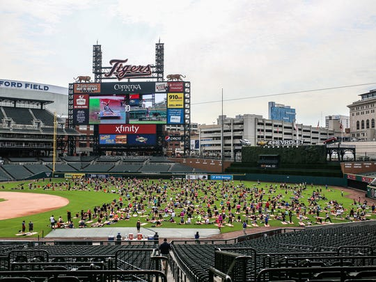 during Yoga Day at Comerica Park in Detroit on Sunday, Aug. 6, 2017. Danialle Karmanos' Work It Out progam is partnering with the Detroit Tigers to raise funds to sponsor Detroit schools' physical education programs.