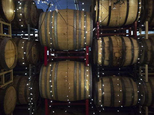 Barrels of Funkwerks beer age in the barrel-room, Friday, August 4, 2017, during a tour of the Funkwerks brewery in Fort Collins, Colo.