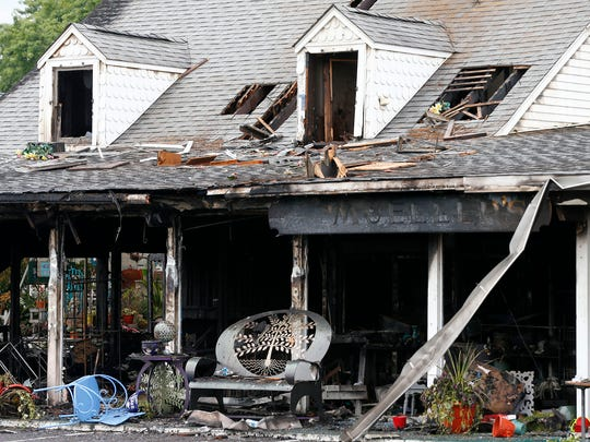 The burned out frame of Mueller's on Route 71 in Manasquan is shown Monday, August 7, 2017.  The floral shop was gutted by a fire Sunday.