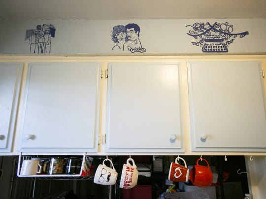 Drawings from Don and Christina Philipp's exchange student Mizuki Kawanuma decorate the walls of their kitchen on Wednesday, Aug. 2, 2017. Kawanuma lived with the Philipps for a year in 2005, and on her last night in the home, they gave her permission to paint memories of her time with them on the wall.