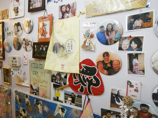 "Gifts and mementos from some of Don and Christina Philipp's 72 foreign exchange students decorate the walls of their Salem home on Wednesday, Aug. 2, 2017. The Philipps have been hosting exchange students from for 17 years and call them ""their children."""