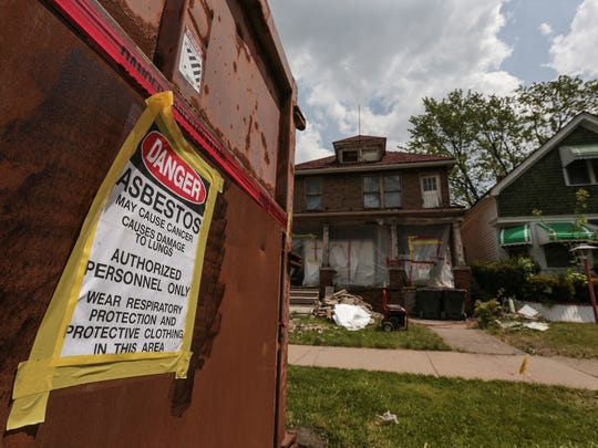 A shipping container sits on Crane St. in front of a house having asbestos abatement on Crane St. in Detroit's east side on Wednesday May 17, 2017.