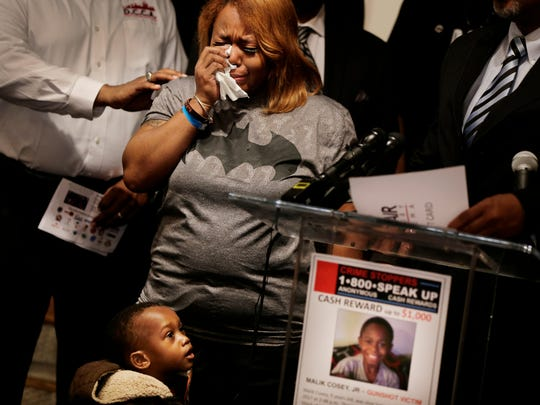 Ciera Milo, the mother of 9-year-old Malik Cosey pleads for the shooter of her son to turns himself in during a press conference with Crime Stoppers of Michigan in Detroit on Wednesday, April 5, 2017.