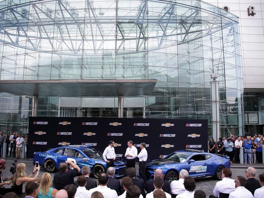 Seven-time Cup champion Jimmie Johnson, left, driver of the #48 LoweÕs Chevrolet for Hendrick Motorsports, joined Mark Reuss, executive vice president of GM Global Product Development and Dale Eanhardt Jr. to reveal the new Camero ZL1 race car at ChevroletÕs headquarters in Detroit Thursday Aug. 10, 2017. Detroit. Mandi Wright/Detroit Free Press