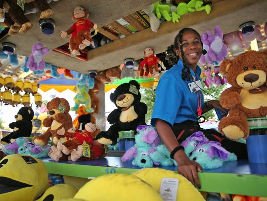 Yolanda Johnson at the water guns game booth in the