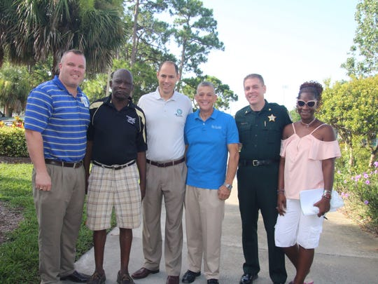 John Teske, Jerome Phamphile, Jason Brown, Joe Flescher, Major Eric Flowers and Linda Morgan attended the Back to School Bash in Gifford.