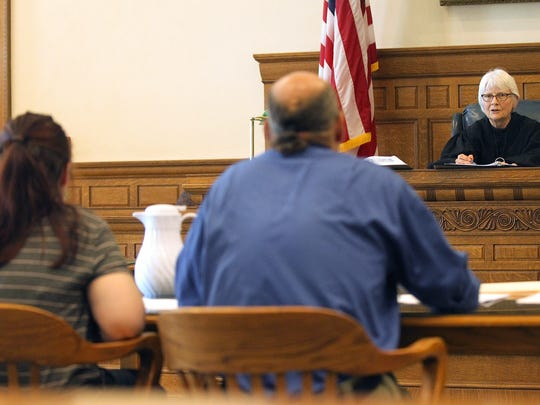 Judge Marsha Bergan speaks with Ashley Hautzenrader during her hearing at the Johnson County Courthouse on Friday, Aug. 11, 2017. Hautzenrader pleaded guilty to child endangerment and to neglect or abandonment of a depended person.