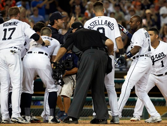 Tigers leftfielder Justin Upton (right) is congratulated