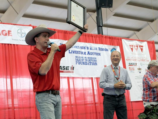 """Governor Scott Walker declares Ben Brancel day at the Wisconsin State Fair on Aug. 9 in recognition of of the Wisconsin Department of Agriculture, Trade and Consumer Protection Secretary's Aug, 13 retirement. Walker said Brancel """"has poured his heart and soul"""" into leading the agency and is """"someone who loves and cares for farm families."""""""