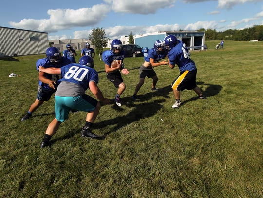 West Liberty linemen run drills during practice on