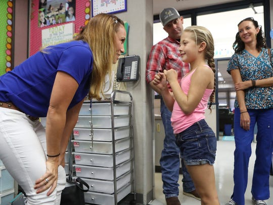 Turtle Bay School first grade teacher Anne Morgan, left, meets her first grade student Hadley Hopper Tuesday during a meet and greet at the school in Redding.