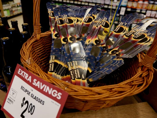 Eclipse glasses are available at a Roth's Markets grocery store in Salem, Ore., on Tuesday, Aug. 15, 2017.