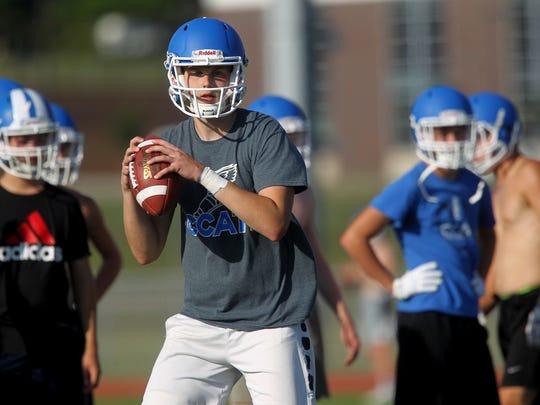 Clear Creek Amana quarterback Ethan Postler runs drills