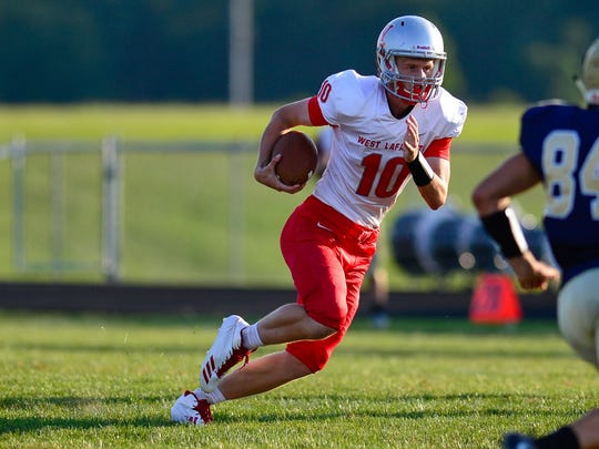 West Lafayette quarterback Luke Touloukian dominated with his legs and his passing arm against Tri-West.