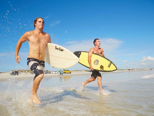 Surfers at Daytona Beach, Florida