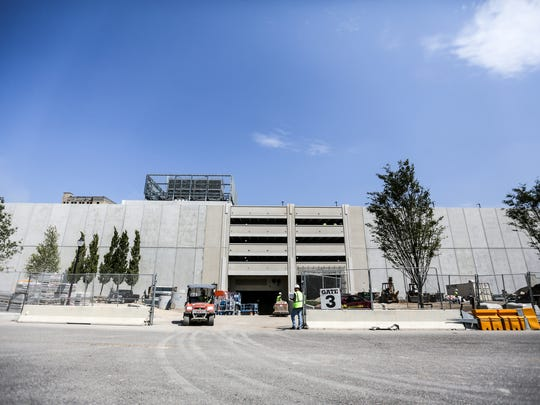 A new parking deck being built for the new Little Ceasar's Arena business district seen along Cass Avenue in Detroit on Monday, Aug. 21, 2017.