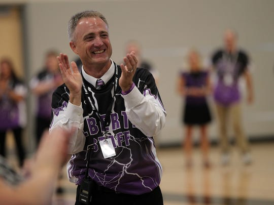 Liberty High Principal Scott Kibby applauds as faculty is introduced on the first day of school in North Liberty on Wednesday, Aug. 23, 2017.