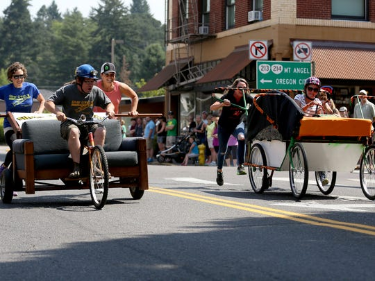 The Silver Crest Rocket Club team, left, and Silverton Class of 1977 team compete in the Davenport Races during the Homer Davenport Community Festival in Silverton on Aug. 6, 2017.