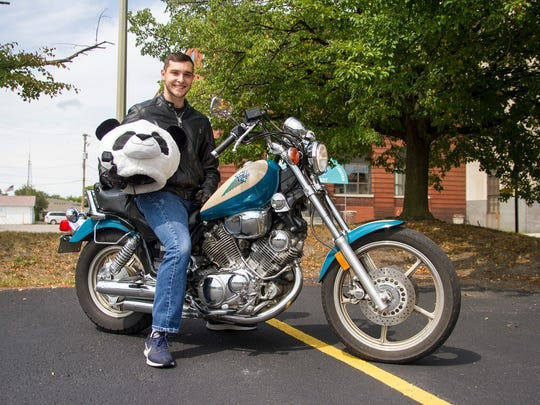 Rick Isaac, 19, of Marysville, cruises the streets of Port Huron on his 1996 Yamaha Virago wearing a panda helmet. Isaac says he does it to bring joy back to the Port Huron and Marysville area by giving people something to laugh about and enjoy.