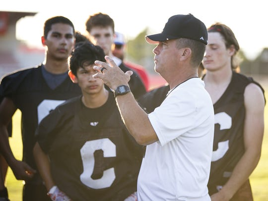 Coach Shane Hedrick talks to players at a Central High