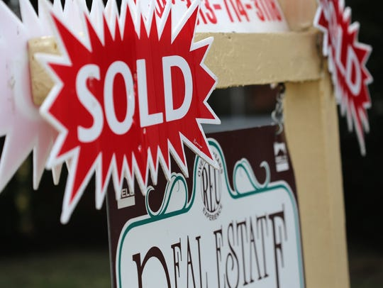 Sold real estate sign.